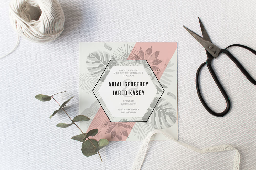 Pink tropical wedding invitation design